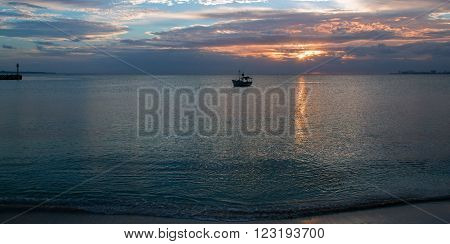 Fishing boat in Puerto Juarez Cancun Mexico at sunrise