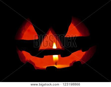A scary Halloween pumpkin on black background