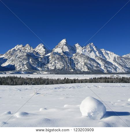Grand Tetons Mountain Range Peaks on a bright sunny morning in Grand Teton National Park in Wyoming USA