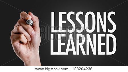 Hand writing the text: Lessons Learned