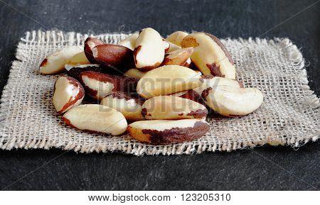 Brazil Nuts (close-up shot) on stone background. Bertholletia.