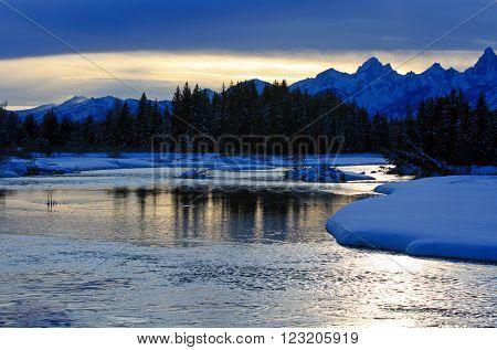 Snake River at sunset below the Grand Teton Mountain Range in Grand Tetons National Park in Wyoming USA