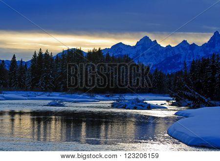 Snake River at sunset below Grand Teton Mountain Range