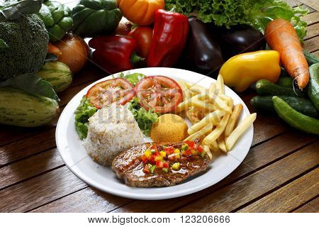 Dish with vegetables and roasted meat