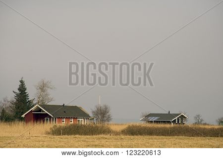 Danish summerhouses in winter nature and close to the sea