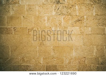 Brown brick wall texture as a background.