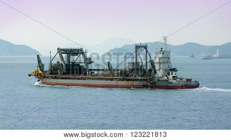 Busan, South Korea - February 24th, 2016: Busan, road of the port of Busan, anchorage of sea vessels, the special ship dredge