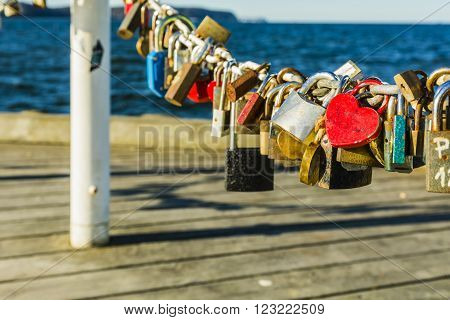 Red padlock in the shape of a heart.