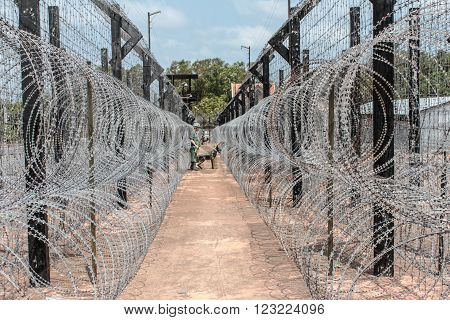 barb wire fence. guarded border , border patrol / prison guard
