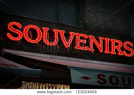 Red neon sign on souvenirs shop in Vienna Austria. Europe travel.