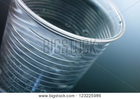 Close Up Of A Plastic Cup Filled Up With Nearly 200Ml Water