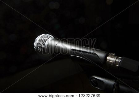 Black Microphone On Black Dark Background.