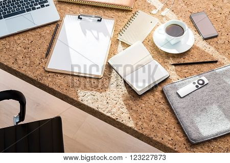 Cork table with notepad datebook coffee and laptop. Concept of work. Mock up. 3D render