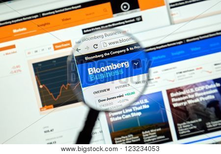 MONTREAL CANADA - MARCH 25 2016 - Bloomberg internet page under magnifying glass. Bloomberg is a privately held financial software data and media company.