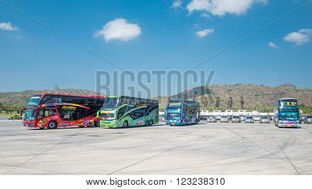 HUA HIN, THAILAND - JANUARY 30: Tour buses at Rajabhakti Park on January 30, 2016 in Hua Hin. Rajabhakti Park is a new tourist attraction displaying giant bronze statues of seven historic Thai kings.