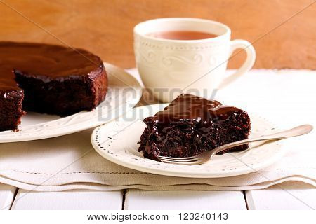 Chocolate fudge cake with berries under chocolate icing
