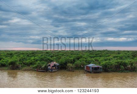 SIEM REAP, CAMBODIA DEC. 16: Cambodian people live on Tonle Sap Lake in Siem Reap, Cambodia on December 16, 2011. Tonle Sap lake, the floating village.