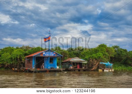 SIEM REAP, CAMBODIA DEC. 16: Cambodian people live on Tonle Sap Lake in Siem Reap, Cambodia on December 16, 2011. Floating House and Houseboat on the Tonle Sap lake, between Battambang and Siem reap.