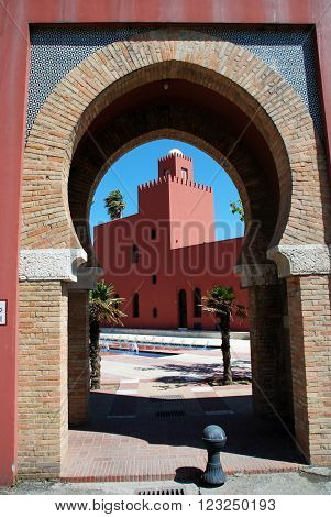 View of Bil Bil castle (Castillo Bil Bil) seen through a Moorish style archway Benalmadena Costa del Sol Malaga Province Andalusia Spain Western Europe.