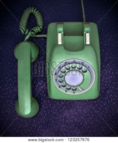 green retro phone from above