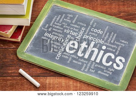 ethics and moral dilemma word cloud - white chalk text on  a slate blackboard with a stack of books
