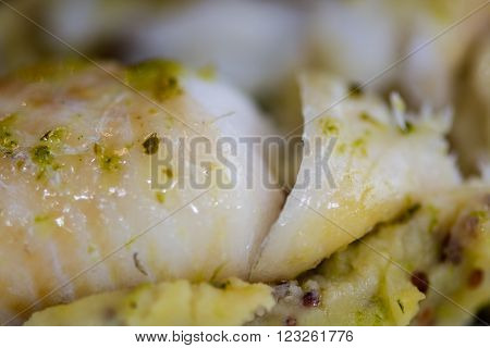 Haddock with whole grain mash and garlic parsley butter detail of fish. French restaurant prepared fish dish with mashed potato