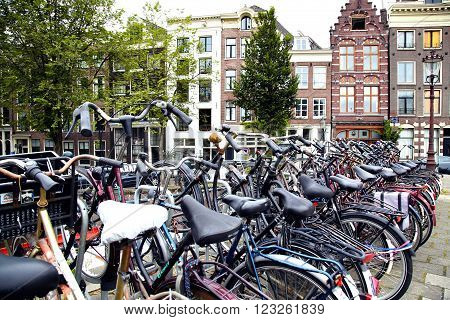 AMSTERDAM; THE NETHERLANDS - AUGUST 16; 2015: Lots of bicycles parked at the bike parking in Amsterdam. Amsterdam is capital of the Netherlands on August 16; 2015.