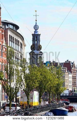 AMSTERDAM, THE NETHERLANDS - AUGUST 19, 2015: View on Bloemenmarkt and The Munttoren (