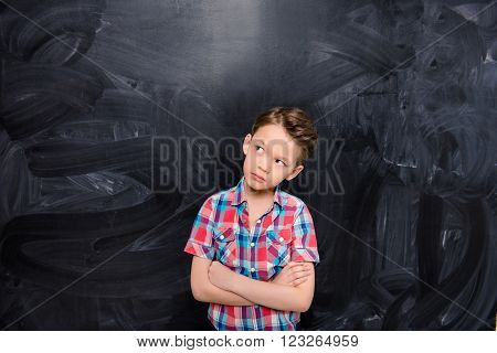 School Concept. Minded Young Schoolboy With Crossed Hands