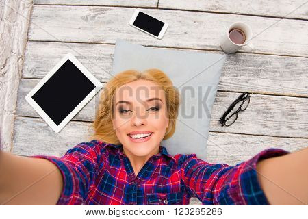 Pretty Happy Blonde Lying On Floor And Making Selfie