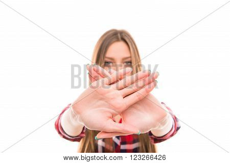 Close up portrait of serious woman with forbidding gesture focus on hands