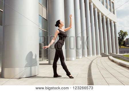 Beautiful Graceful Ballerina Dancing In The Front Of The Building