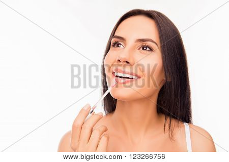 Young Woman Doing Maquillage With Lipstick, Close Up Photo