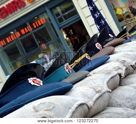 BERLIN - AUGUST 9 2012: Checkpoint Charlie between east and west sectors during the Cold War with the Soviet military caps on sandbags