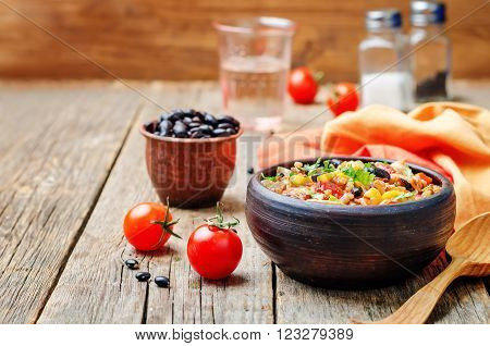 Black beans corn and tomato red and white rice with chicken.