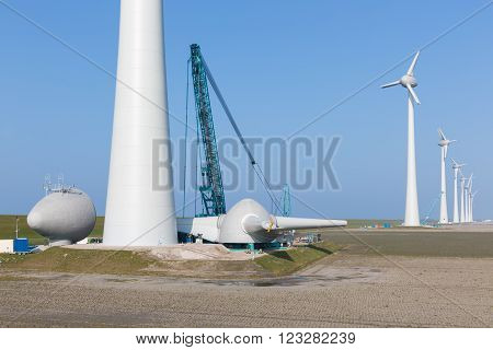 Dutch farmland with construction site new wind turbine farm