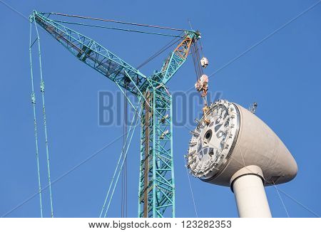Installing rotor house at the top of a big new Dutch wind turbine ** Note: Soft Focus at 100%, best at smaller sizes