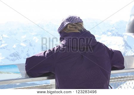 Young woman from the back. Observation platform on the Kaprun Austria.