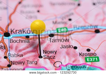 Photo of pinned Nowy Sacz on a map of Poland. May be used as illustration for traveling theme.