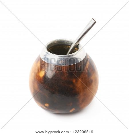 Calabash mate gourd with a bombilla drinking straw inside it, composition isolated over the white background