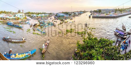 Soc Trang, Vietnam - February 3rd, 2016: Panorama landscape morning floating market wetland busiest night with boats transporting agricultural products to trade in this sunny morning preparing for the Lunar New Year in wetland Soc Trang, Vietnam