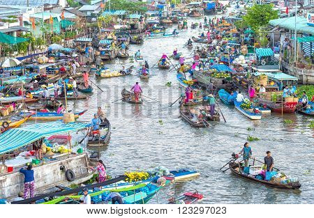 Soc Trang, Vietnam - February 3rd, 2016: Conversely swept the boat trip on the floating market with hundreds of boat people moving transport, agricultural products represent bustling river waterways cultural beauty in Soc Trang, Vietnam