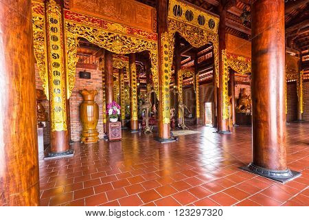 Can Tho, Vietnam - February 4th, 2016: Beauty of Truc Lam Monastery architecture with large wooden poles, roof tiles, floor tiles Bat Trang are all red create a cool atmosphere, chastity for spiritual practice Can Tho, Vietnam