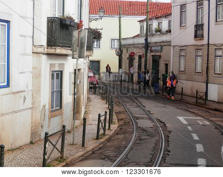LISBON, PORTUGAL MARCH 15TH. Tramlines winding through narrow Lisbon street. Lisbon Portugal March 15th 2016
