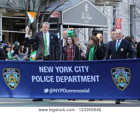 NEW YORK - MARCH 17, 2016: New York's mayor Bill De Blasio (L) and Police Commissioner William Bratton marching at the St. Patrick's Day Parade in New York.