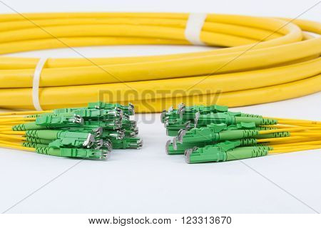 fiber optic E2 (LSH) pigtail patchcord connectors on white background poster