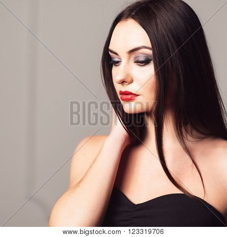 Young attractive woman with bright creative make-up. Sexy girl with creative make-up. Studio shoot of thoughtfull brunette.
