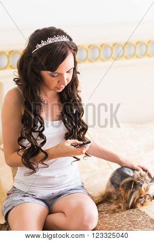 Cute young girl with her Yorkie puppy.