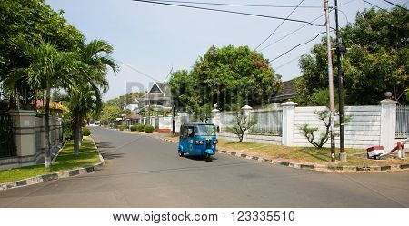 JAKARTA, INDONESIA - AUGUST 27, 2015: betjak is driving through Kayu Putih neighbourhood in Jakarta, Indonesia