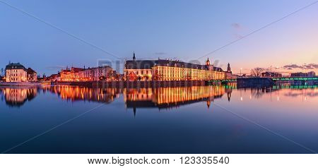 A cityscape of Wroclaw, view from river Odra, in the evening. Poland, Europe. Panorama.